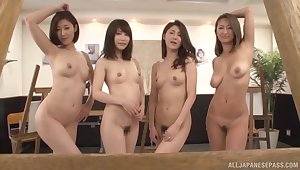 Lucky person enjoys getting his dig up pleasured by four Japanese models