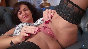 Foxy mature Lucy Heart in stockings and lingerie having some fun